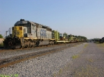 CSX 8023 idles with MoW equipment