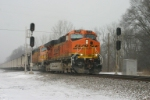 BNSF 7615 crawls along with FEPX loads