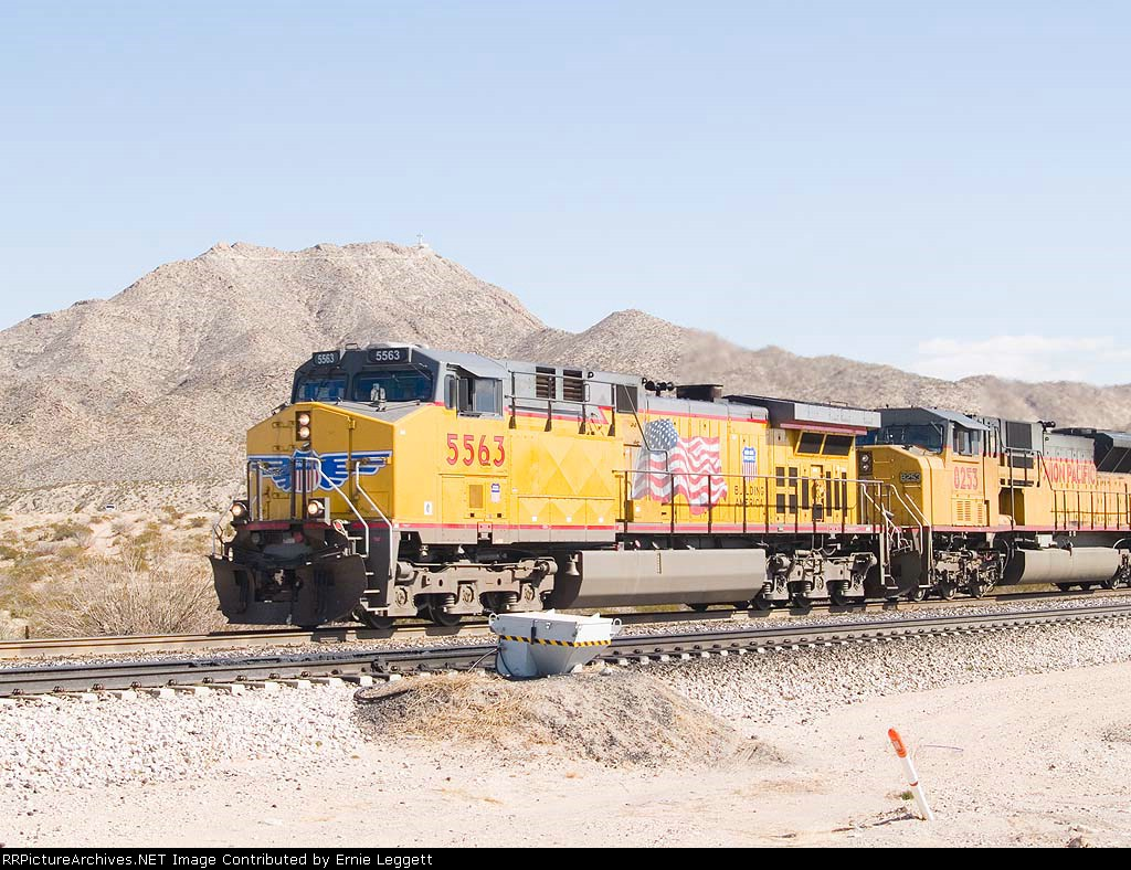 UP 5563 leads a WB grain train at 12:20pm