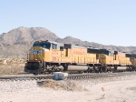 UP 4374 leads a WB intermodal at 10:56am
