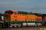 BNSF 5694 on BNSF Transfer to NS - crew member poses for camera