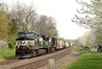NS 9499 leading mixed freight westward along UP Jeff City Sub