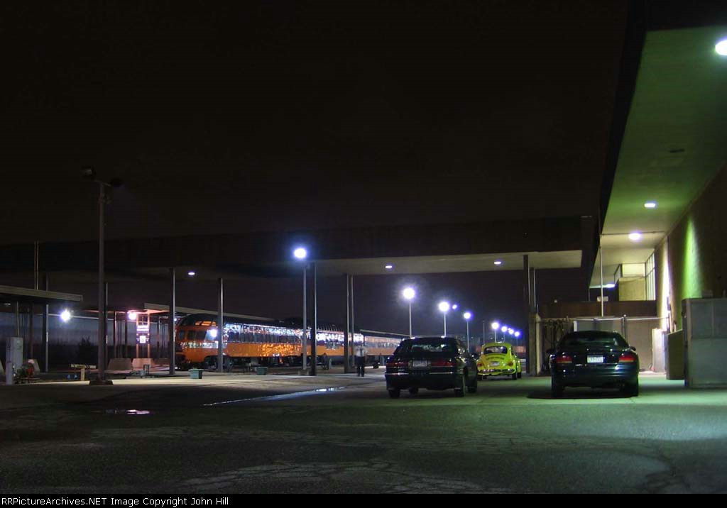 """07050726 MILW Skytop """"Cedar Rapids"""" and """"Super Dome 53"""" at Amtrak's Midway depot at night"""