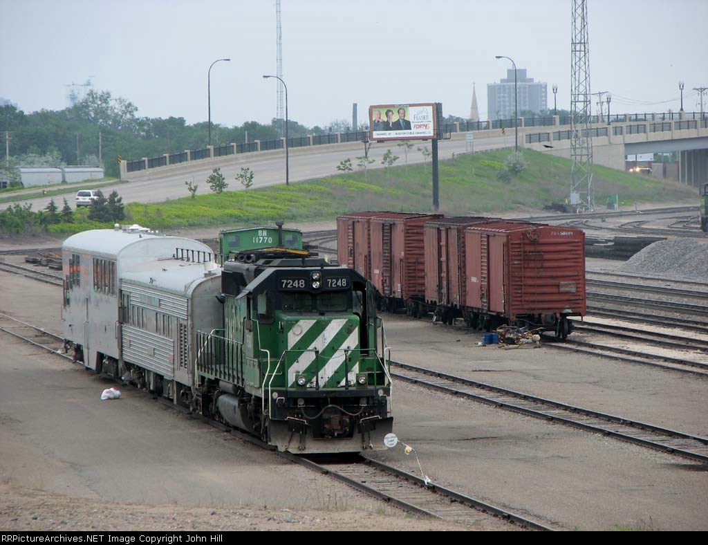 "07052215 BNSF inspection train parked in the Northtown ""T"" Yard"