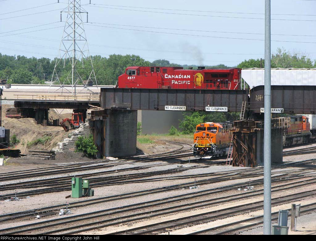 070616001 Westbound CP freight passes over eastbound BNSF freight at Northtown CTC 35th