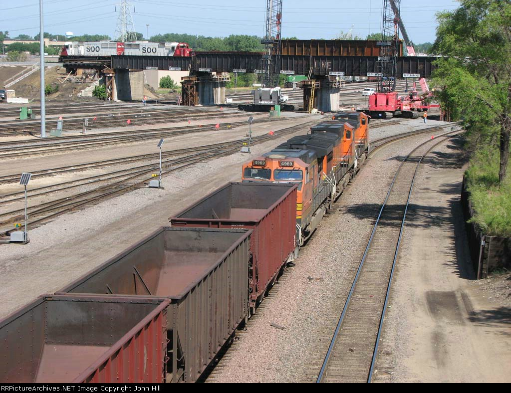 070709035 BNSF BIRSEM taconite ore empties rolls through Northtown Yard on the North Receiver