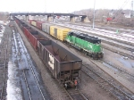"070312017 Northbound BNSF All-Rail taconite empties on main at Northtown CTC 35th while ""Grove"" switcher works the yard"