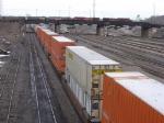070314005 BNSF westbound intermodal passes under eastbound CP freight on bridge