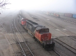 070324012 In dense fog, CN/WC Transfer on North Runner delivers to BNSF Northtown near CTC 35th