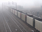 070324017 In dense fog, NSPX coal empties from Daytons Bluff being delivered to BNSF Grove (Northtown) at CTC 35th