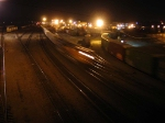 070326037 Night view of westbound intermodal train passing BNSF Daytons Bluff and CP St. Paul yards