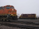 070403017 Eastbound BNSF freight at CTC University on St. Paul Sub. passes pre-RailRunner TC&W intermodal job switching at CP Shoreham Yard