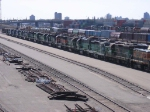 """07040709 Stored BNSF locos rest in the Northtown """"T"""" yard while luckier siblings rumble past on the nearby main"""