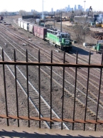 """07040904 BNSF Northtown """"Grove"""" switcher crossing mainline at CTC 35th as seen from ancient St. Anthony Parkway bridge."""
