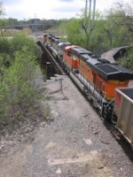 """07042709 Westbound DEEX coal empties (passing former CGW """"Boom Island Junction"""") about to cross Nicollet Island on BNSF Wayzata Sub."""