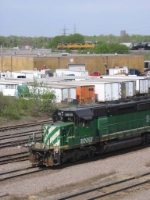 07042923 BNSF yard engine at Northtown near CTC 35th while a westbound UP train on CP rails nears the Camden bridge