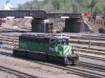 07050103 BNSF engine 7821 rolls through Northtown Yard near CTC 35th while pre-demolition work continues on CP/SOO bridge in the background