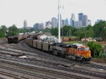 07053113 BNSF road power reaches into Grove Yard near Northtown CTC 35th to double its empties together for departure