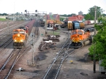 07053114 BNSF taconite empties on left pass coal empties in Grove Yard on right at Northtown CTC 35th