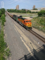"070715002 Westbound BNSF (DEEX) coal empties roll through downtown ex-GN/BN ""Hole In The Wall"" (1st Street North) on Wayzata Sub."