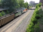 """070715003 Westbound BNSF (DEEX) coal empties roll through downtown ex-GN/BN """"Hole In The Wall"""" (1st Street North) on Wayzata Sub."""