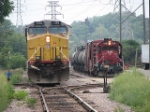 070827019 DPU on northbound UP coal train on MNNR near BNSF Park Junction passes one of the oldest Alcos still operating anywhere