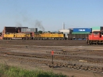 "070829063 Southbound UP coal passes a waiting CN ""WC Transfer"" at BNSF Northtown ""T"" Yard"
