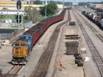 """070830015 Southbound BNSF """"All rail"""" taconite ore train pauses at Northtown CTC 44th for fuel and crew change."""