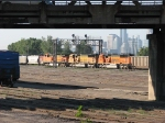 """070831016 BNSF 9839 """"Swoosh"""" repaint trails on southbound DEEX coal empties at BNSF Northtown CTC 35th"""