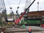 071010038 BNSF Northtown Yard action continues as final span of new CP bridge is set in place
