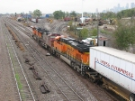 071012004 Eastbound BNSF stack train passes Northtown CTC 35th heading for Midway Yard.
