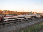 071022054 Private passenger cars seen on eastbound BNSF freight at Northtown Yard
