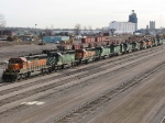 """071127005 Fresh lineup of BNSF stored SD40-2 power at Northtown """"T"""" Yard"""