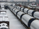 """071227006 BNSF Northtown """"T"""" Yard is populated with wide-loads, marked """"Vestas"""",  looking like maybe wind turbine tower segments?"""