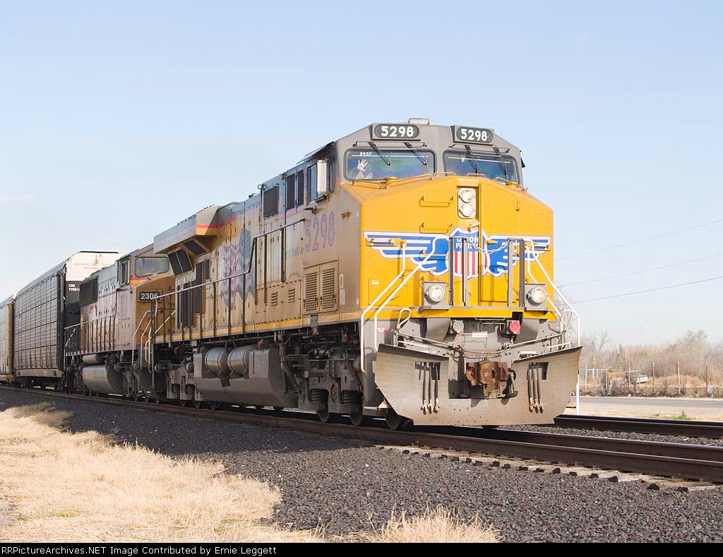 UP 5298 leads an empty EB autorack at 8:52am