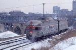 1034-24 AMTK 334 departs Mpls GN passenger depot with eastbound Amtrak Hiawatha and crosses Stone Arch Bridge