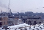 1034-25 AMTK 334 departs Mpls GN passenger depot with eastbound Amtrak Hiawatha and crosses Stone Arch Bridge