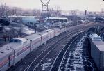 1035-19 Eastbound Amtrak North Coast Hiawatha with deadhead cars passes BN Como Yard