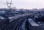 1035-21 Eastbound Amtrak North Coast Hiawatha with deadhead cars passes BN Como Yard