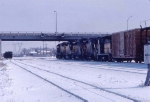 1037-03 Eastbound CNW freight on BN/GN freight main near Snelling Avenue