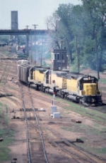 "1052-06 Eastbound C&NW freight departs E. Mpls Yard via BN ""St. Anthony"" junction"