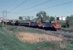 1053-13 Westbound SOO Line freight passes under Silver Lake Road near Apache Plaza