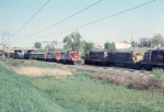1053-20 Rocky-Soo Transfer meets westbound SOO freight passing under Silver Lake Road near Apache Plaza