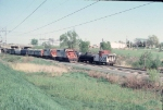 1053-22 Rocky-SOO Transfer meets westbound SOO freight passing under Silver Lake Road near Apache Plaza