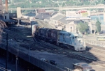 1055-10 Rocky-SOO Transfer passes SPUD about to cross river. Now-gone MILW freight house in background.