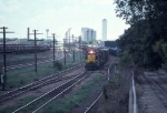 1058-07 Eastbound C&NW freight passes MILW Bass Lake Yard
