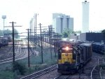 1058-07a Eastbound C&NW Freight Passing MILW Bass Lake Yard