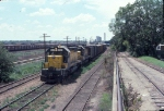 1058-08 Eastbound C&NW freight passes MILW Bass Lake Yard