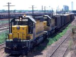 1058-08a Eastbound C&NW Freight Passing MILW Bass Lake Yard