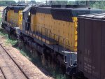 1058-10a Eastbound C&NW freight passing MILW Bass Lake Yard